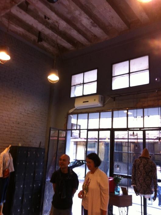 Tan and Jan looking at a designer shop next to La Duree at Zone 9.