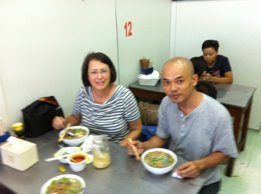 Jan and Tan enjoying banh da noodle fish soup (my photo).