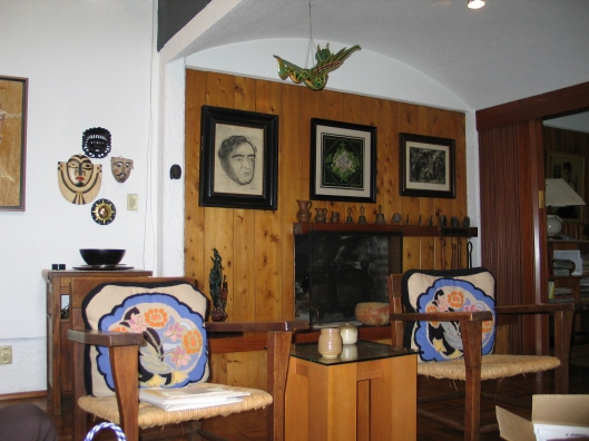 Chavez's Coyoacan living room with his portrait by Siqueiros on the wall.