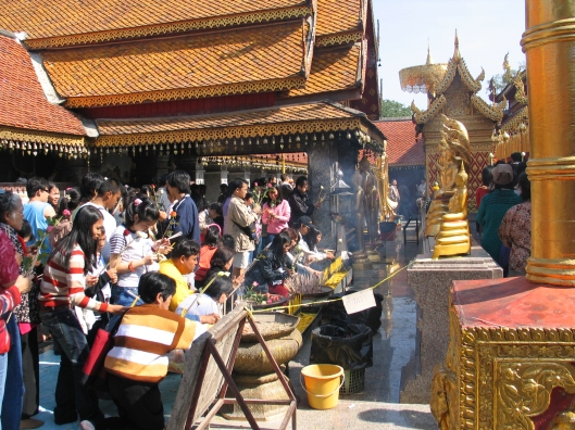 Praying in Chiang Mai for tsunami victims.