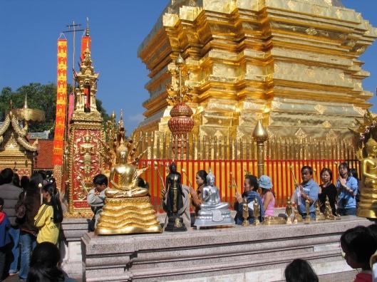 Thai pilgrims circling Buddha's relic.
