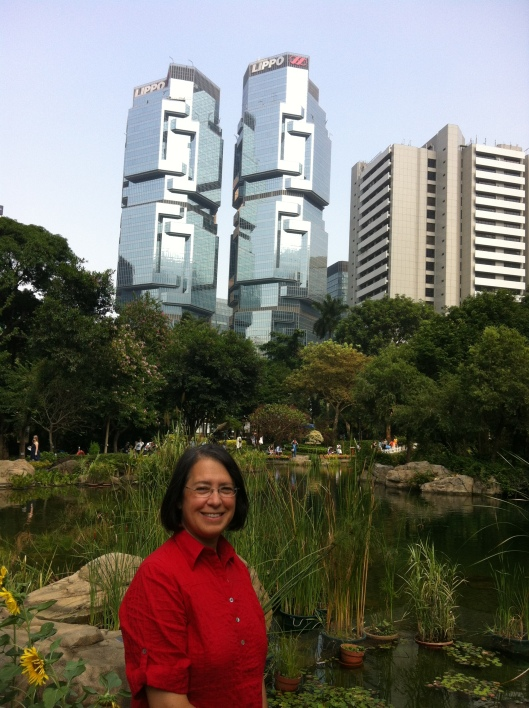 Yin Yang in Hong Kong: Jan in HK Park with skyline as backdrop.