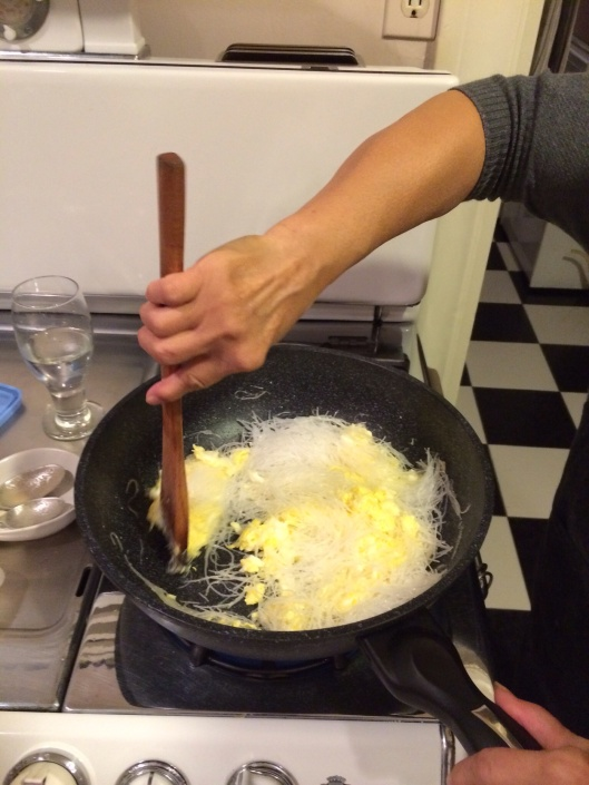 No sticking together if you scramble your eggs in oil before adding glass noodles.
