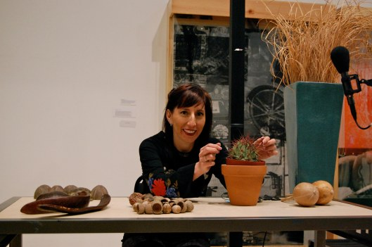 Lynn and her cactus & plants with Rauschenberg as backdrop.