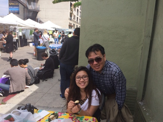 Father and daughter at the Hollywood.Farmers Market.