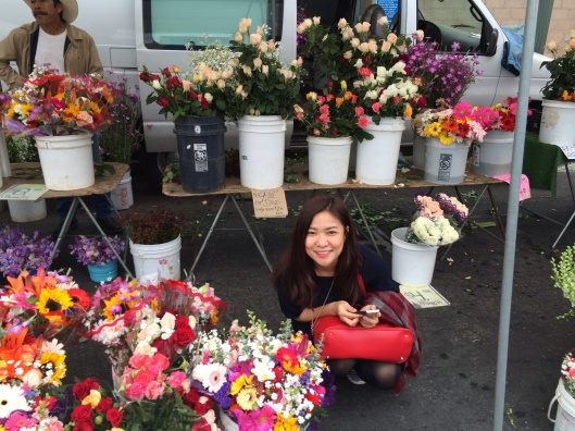 Violist Do Huong Tra My with California flowers.