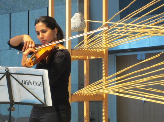 Shalini Vijayan performing Cage in Los Angeles within a sculpture of Minkeo Grimmer.