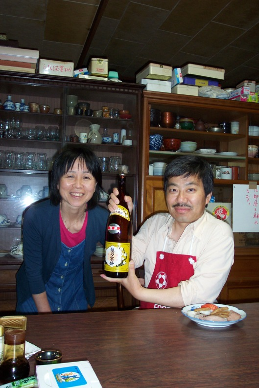 Miko and Ippei showing us their favorite sake in 2002.