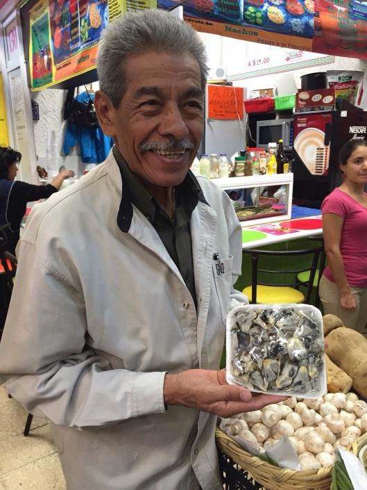 A proud vendor with huitlacoche in Mercado Coyoacan.