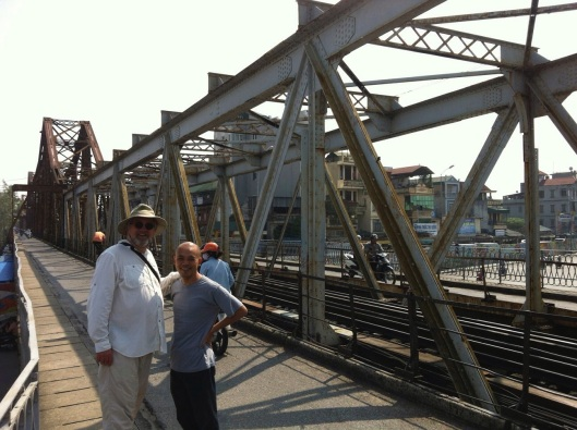 With composer Vu Nhat Tan at Gustave Eiffel's Long Bien Bridge in Hanoi.