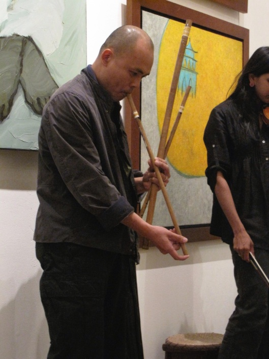 Vu Nhat Tan's ancient wood flutes.