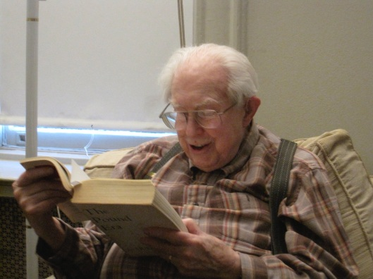 Elliott reading Ezra Pound in 2010.