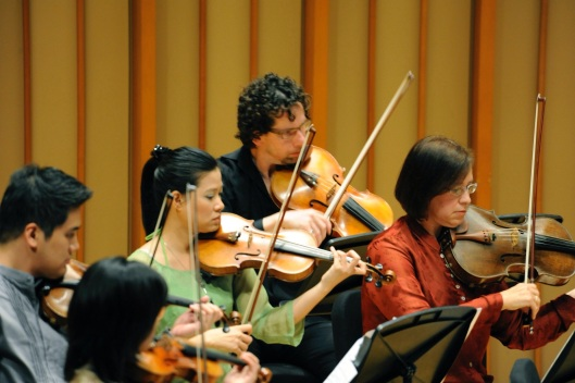 Vietnamese and American players performing together in 2010.