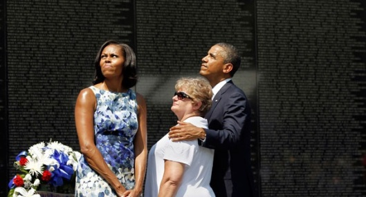 With a widow of a Vietnam Vet, the President and first Lady at the Vietnam Memorial.