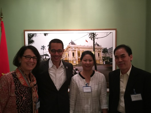 Behind Karnow's daughter, Jan and Clayton with Duong Thanh Binh and Dr. Minh Anh of VNAM.