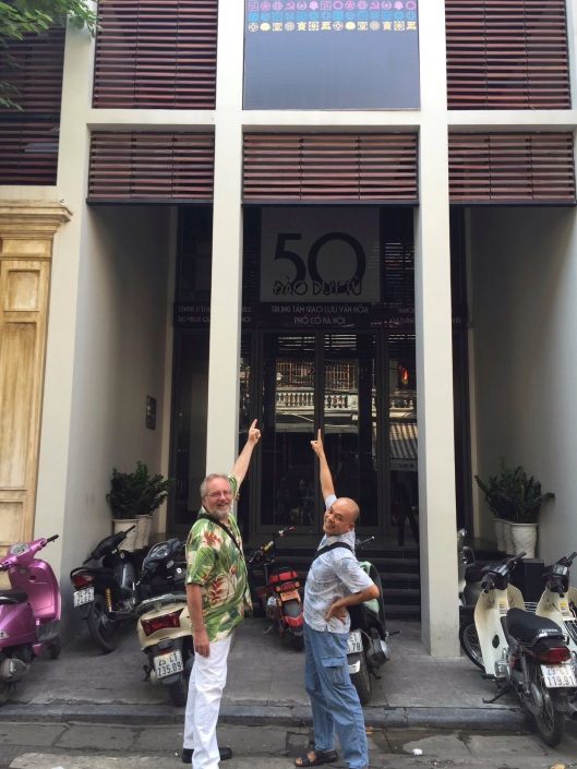 Composer Vu Nhat Tan and I outside the Old Quarter Cultural Center.