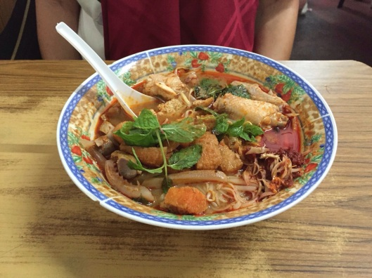 A full bowl of Famous Penang Curry Mee from down the street.