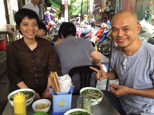 KKImnogc Tran and Vu Nhat Tan enjoy pho bo.