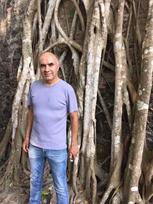 Ricardo by a banyan tree in Antigua.