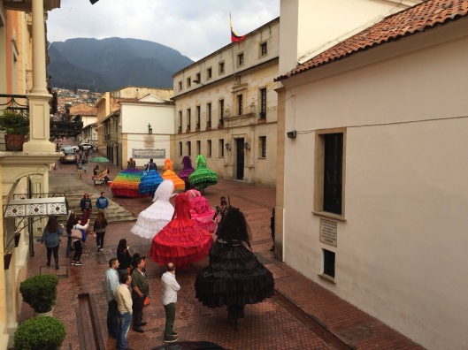 Stilt women head towards the Andes in La Candelaria.