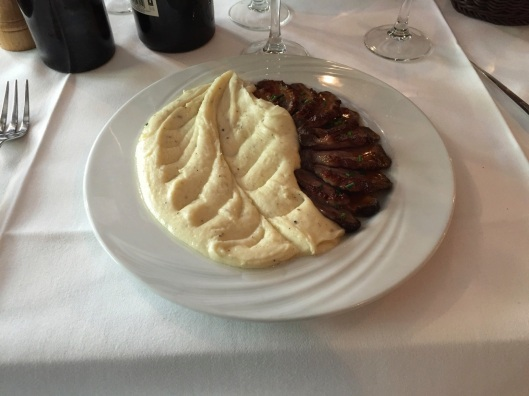 Duck breast and aligot (cheese whipped) mashed potatoes.