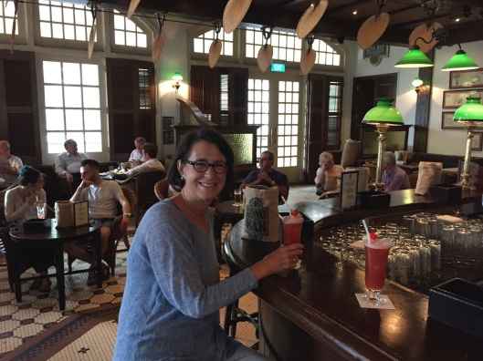 Jan and the Raffles' Long Bar with an unforgettable atmosphere of Maugham.