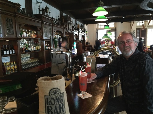 Enjoying my Singapore Sling at the Long Bar.