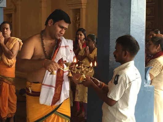 A HIndu blessing at the Batu Caves (notice the iPhone in the priest's robe).