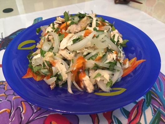 A refreshing chicken and onion salad with rau ram (laksa leaves).