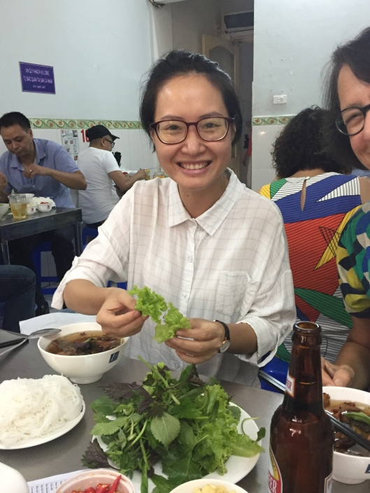 A smiling Bông Hoa shows us the right bun cha etiquette.