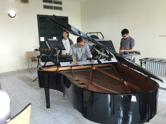 Pianist Tam Ngoc Tran takes to being inside the piano like a fish to water.
