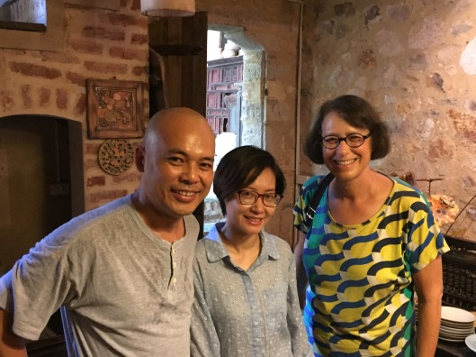 Tan, Bông Hoa and Jan in the cool earthen ceramic room.