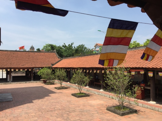 Spirit flags floating in the wind at Chua Dau.
