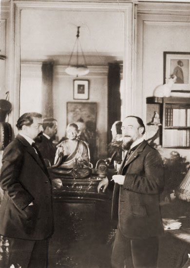 The Buddha on the mantle in Debussy's Paris apartment with Erik Satie (photo probably by Igor Stravinsky).