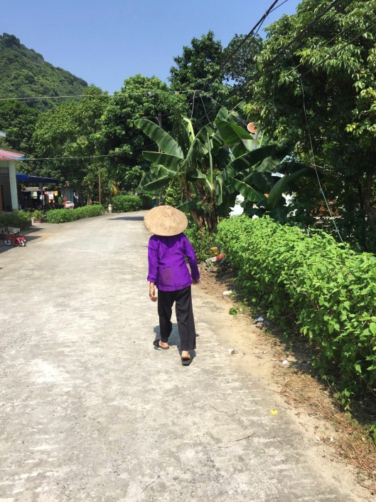 A woman leading me forward on Cat Ba Island.