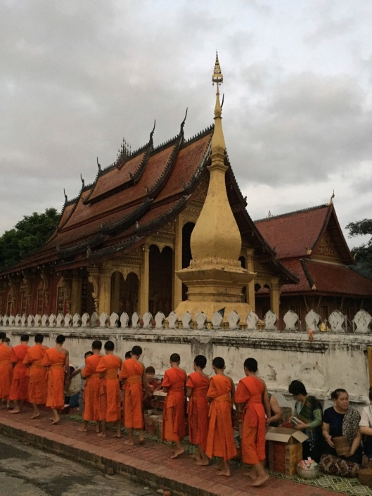Monks file in silence through the streets of Luang Prabang every morning.