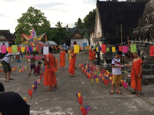 People and monks join together.