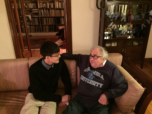 19 year old Nguyễn Minh Nhật listening to 93 year old William Kraft tell him about Igor Stravinsky.