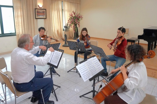 Rehearsing a new quartet by 19 year old Nguyen Minh Nhat.